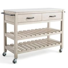 The appealing Wood Bar Cart with White Marble Top from Bee & Willow Home is a fresh, country version of the classic bar cart. Features storage drawers, slatted shelves and a beautiful engineered marble top that is perfect for food preparation.