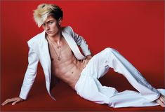 Lucky Blue Smith wears a white leather suit from Kenzo.