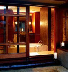Bathroom with dark wood door and window frames