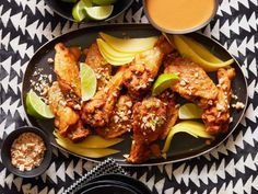 West African Spicy Peanut Chicken Wings : The spicy, savory flavors of chicken mafe, a West African specialty, inspire the sauce that coats these flavorful wings. Frying the wings twice — first at a lower temperature and once again at a high one — creates super-crispy skin. To get a head start on a party, you can fry the wings the first time the day before, freeze the wings overnight, then fry them again just before serving.