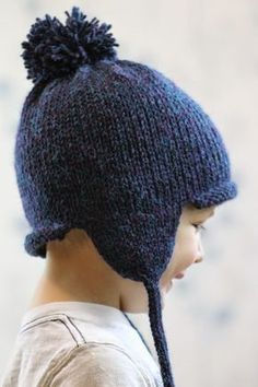 Free hat knitting patterns for children. This knitted earflap pom pom hat is a quick knit for beginners.