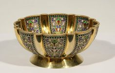 KHLEBNIKOV GILT SILVER AND PLIQUE-A-JOUR, IVAN KHLEBNIKOV HALLMARK, MOSCOW, CIRCA 1908-1917. oF SCALLOPED FORM ON A SPREADING FORM , THE LOBED PANELS DECORATED WITH SCROLLING FOLIAGE IN DELICATE SHADES OF MAUVE, GREEN, YELLOW, BLUE AND RED TRANSLUCENT ENAMEL, SURROUNDED BY EMAERALD GREEN BORDERS