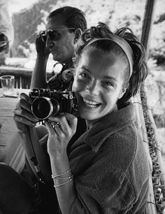 ROMY SCHNEIDER WITH HER NIKON CAMERA