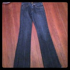 7 For All Mankind Boot Cut Jeans 7 For All Mankind Boot Cut Jeans: gently worn and very flattering! Slight tear at the cuff, identical on each side (barely noticeable - see photos- that is after separating the fabric for the photo); inseam is 34 inches 7 for all Mankind Jeans Boot Cut