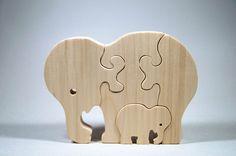 Elephant Puzzle Wood Baby Elephant Eco by littlewoodenwonders, $12.50  My cousin makes these. No joke.
