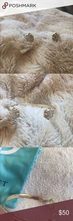 Bracelet Kendra Scott This does not look well with my skin. I am too pale for it. It is shiny and sparkly. Worn a few times. Gold with a white sparkly stone on each side, comes with bag. Kendra Scott Jewelry Bracelets