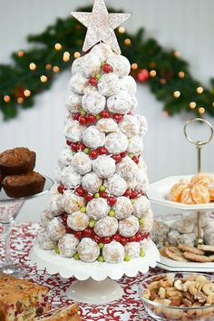 A donut hole Christmas tree might well be everyone's favorite stop on the brunch buffet. Super easy to make.