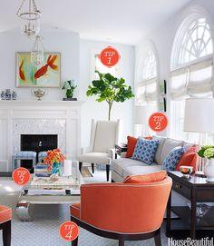 """The Challenge: The furniture layout was a major concern for the clients, who needed ample seating for entertaining — but didn't want to overcrowd the decor. Complicating matters, the room's proportions are long and somewhat narrow, with underutilized alcoves flanking the fireplace. Tip 1: Put Dead Space to Work """"There were awkward nooks with high windows on either side of the fireplace, and I wanted them to feel intentional. A pair of wing chairs softened the angularity and extended the ..."""