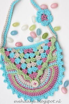 Design by Eveline de Hollander   mei 2013         What do you need:   Yarn (I use 4 colors, beige, turkois pink and green)   1Button...