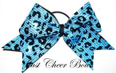 Turquoise Cheetah Sequin Bow I want it :)