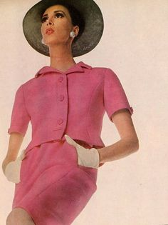 Wilhelmina is wearing a rose pink short-sleeved suit of worsted whipcord by Ben Zuckerman, photo by Penn for Vogue, 1966