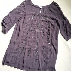"""NWOT Monsoon Tunic/Dress A flowing, loose, beaded tunic that transitions easily between seasons! NWOT, but has a few missing pieces (see pic 4). Sleeves can be worn buttoned up or down. Monsoon is a popular label in the UK. and Europe. Bust: 22"""", Waist: 24""""-26"""", Length: 35"""". Monsoon Dresses"""