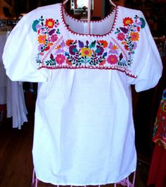 So beautiful, and hand-embroidered in Chiapas, Mexico!   @Lissa Waxler, this has you written all over it.