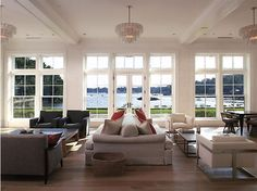 Monster size living room with an amazing water view! Love the multiple chandeliers and double sofa