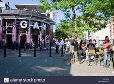 Stock Photo - People relax in Manchester's Canal Street aka the Gay Village on a sunny day in the city centre Sunny Days, Manchester, Sunnies, Centre, Gay, Relax, Street View, The Unit, Stock Photos