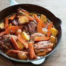 Try the Braised Chicken Thighs with Carrots, Potatoes and Thyme Recipe on williams-sonoma.com/