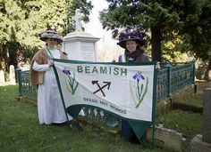 Credit: Flickr Two Edwardian suffragettes stand by Emily Wilding Davison's grave at St Mary's Church in Morpeth, where a service is held yearly as part of International Women's Day celebrations. Emily Wilding Davison was a suffragette who sacrificed her life under the king's horse at the 1913 Epsom derby. By Beamish Museum