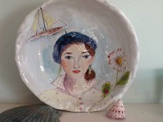IL De France. Large porcelain bowl painted with French Girl and raised flower, boat along the Seine.