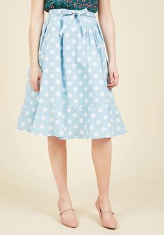 <p>Feeling like you missed the best style of bygone times? This powder blue circle skirt inspires a nostalgic fashion revival with its fun print of white polka dots, its sassy side pockets, and its swingy, tulle-lined silhouette, making throwback moments a present-day possibility!</p>