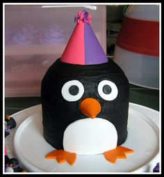 I think you could make a penguin the same way as the owl. Penguin cake party hat Pink and Purple