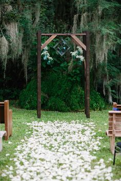 simple wedding ceremony backdrop with hanging greenery and glass decor #weddingceremony #weddingdecor #weddingchicks http://www.weddingchicks.com/2014/01/30/time-travel-wedding/