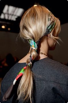 Head scarf entwined ponytail.