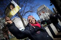WASHINGTON, DC - JANUARY 19: Shaun Jackson sports an American flag hat as she sells Obama calendars as Washington prepares for President Barack Obama's second inauguration on January 19, 2013 in Washington, DC. The U.S. capital is preparing for the second inauguration of U.S. President Barack Obama, which will take place on January 21. (Photo by Mario Tama/Getty Images) Presidential Inauguration, January 21, Michelle Obama, Barack Obama, Washington Dc, Canada Goose Jackets, American Flag, Presidents, Mario