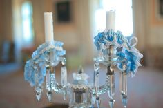 Blue Garters on a candlestick. Blue Garter, Candlesticks, Groom, Dress Shoes, Chandelier, Ceiling Lights, Bride, Wedding Dresses, Decor