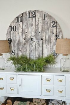 I love big, antique clock faces in a space, but the real deal can be super expensive, so I love Liz Marie's DIY version made out of the end ...