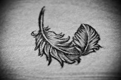 great example of a feather tattoo with movement