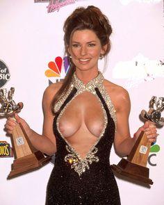 Shania Twain ~ poor girl put her dress on backwards