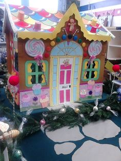 Gingerbread house by Ivy Prentis - 2014 NZ Cardboard playhouse kitset painted & decorated as a gingerbread house. Enjoy!