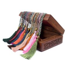 Long boho necklaces with Buddha charm available in 15 shade of colors as seen in pictures.
