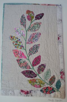 Mandy Pattullo  Unframed appliqued picture on to old piece of quilt