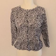 August Silk Leopard Pinup Cardigan size M-L Leopard print cardigan from August silk. Worn and washed once, and in mint condition. Has long sleeves and buttons up the front. Has stretch so can fit a size m-XL. Bust stretches to 49, waist 34. august silk Sweaters Cardigans