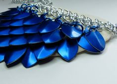 The scales for this stunning necklace come from the Blue Dragon. The Blue Dragon likes to splash in puddles and dance in the rain. It also likes to freak people out by pretending to be the Loch Ness Monster or Ogopogo. It has a bit of a twisted sense of humour, but really intends no harm.
