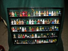 Handcrafted Solid Oak Painted Black Lego Minifigure Display Shelf hold up to 100 figures  w/ Gray 2X Lego Plate. $36.99, via Etsy.