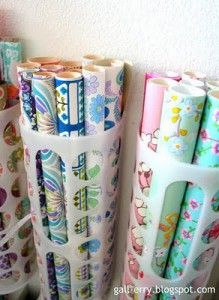 Gift wrap storage (plastic bag holders from IKEA) http://lilluna.com/craft-room-organization/craft-room13/