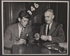 John F. Kennedy about to sign a card on the 1946 campaign trail
