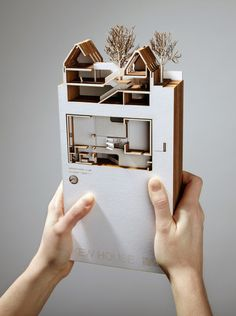Awesome!  Representing a section through book form is an awesome way to let the client flip through the different sections of their home. I think this is a pretty genius idea and, with a laser cutter, would not be that hard to make.