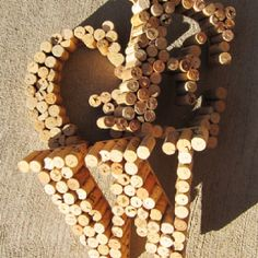 Use corks for host initials for wine party or centerpiece on main table with wine, cheese, etc.