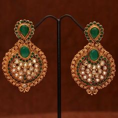 Nawabi earrings studded with white stones and emeralds