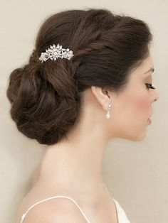 Petite rhinestone bridal hair comb featuring a beautiful vintage inspired floral design in a soft low bridal updo by Hair Comes the Bride.