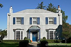 gray house with blue trim