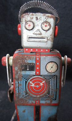 vintage tin robot. LOL...my brother had this & after a while, all the parts started disappearing. I remember just the main body part was left & then that disappeared. Mom must have thrown it out. LOL