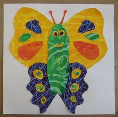Eric Carle inspired butterflies. Use paper with scratched lines into wet mixed paint. Let it dry. cut out shapes for butterfly. Glue together