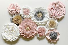 "MADE TO ORDER: Paper flower backdrop for weddings, parties, photo shoots or home decor. This listing is for a beautiful handmade paper flower wall arrangement Items Included: (4) medium paper flowers: 9""-10"" across (6) small paper flowers: 6""-8"" across These flowers are a perfect"