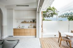 Kyal and Kara used airy sheer curtains in Alexandra Smoke to provide daytime privacy and a beautiful diffused light on sunny days, while minimalistic blockout roller blind provide added functionality without compromising on style. Weatherboard Exterior, Kyal And Kara, Stacking Doors, Sliding Wall, Studio Kitchen, Kitchen Design, Timber Deck, Studio Living, Have A Shower