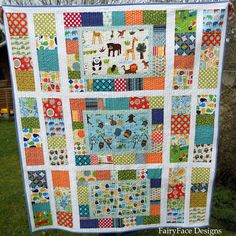 FairyFace Designs: PictureBox Quilt pattern/tutorial, finished size 53 x 60 (smaller than twin).  Feature fabric panels are 10.5 x 16. Turn center panels 90 degrees and widen side strips?