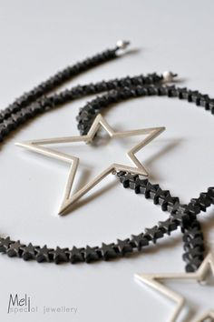 Two sandblasted sterling silver stars linked with Hematite star-shaped beads. Star Necklace, Pendant Necklace, Star Jewelry, Unique Jewelry, Poppy Brooches, Hematite Necklace, Gifts For Teens, Silver Stars, Star Shape